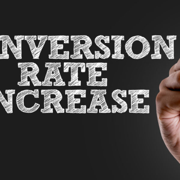 Hand writing the text: Conversion Rate Increase